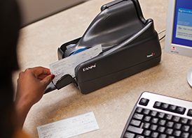 Deposit checks into your Arvest account remotely by using a scanner.