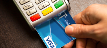 Image showing the payment process using a chip-enabled Arvest Debit Card