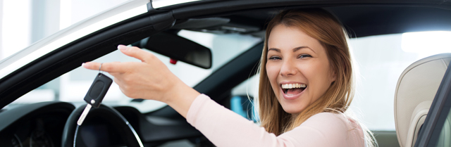 woman in car smiling