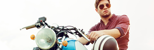 man wearing sunglasses sitting on motorcycle
